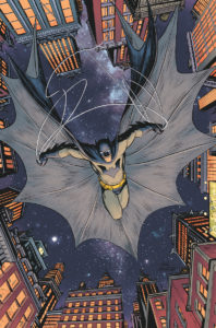 Batman leaping from a rooftop descending at the reader