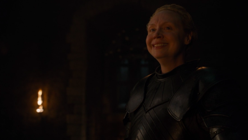 Brienne of Tarth (Gwendolyn Christie) smiles happily after earning her knighthood