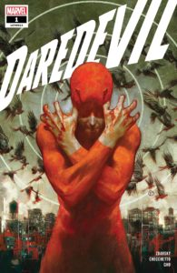 Daredevil stands with his arms crossed and his hands covered in blood