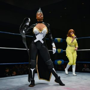Storm standing in the ring with her Championship belt.