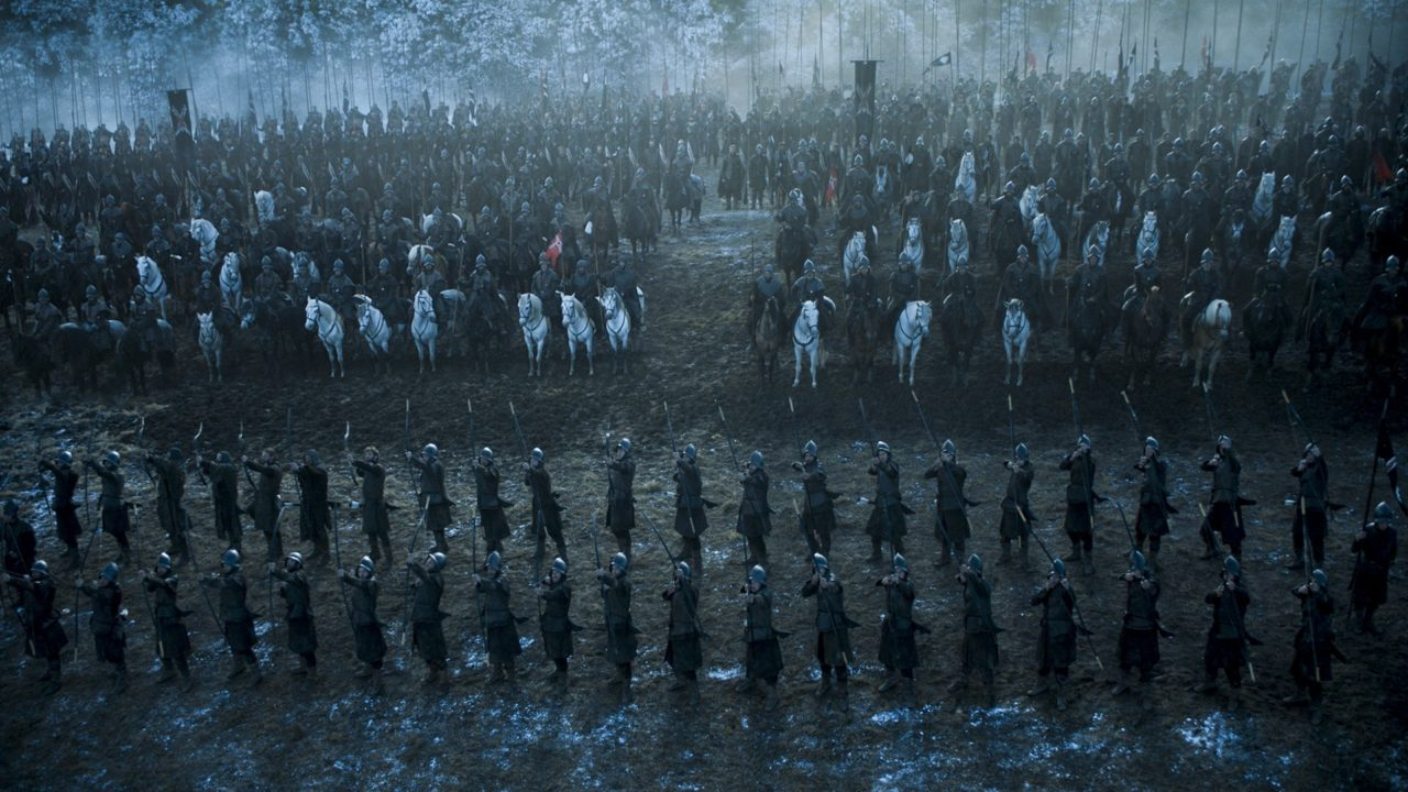 Archers line up in two rows in front of a row of cavalry, followed by infantry