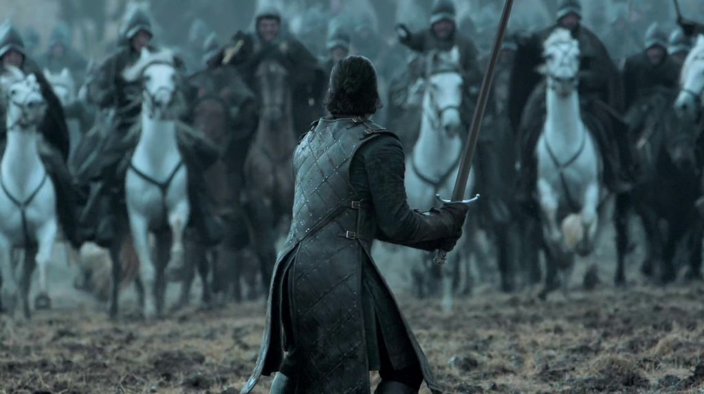Jon Snow stands alone against a charge of cavalry