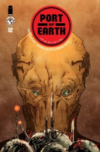 Port of Earth #12 (Top Cow Comics, July 2019) - An alien head with yellow skin, green eyes, and what looks like a mask around the lower half of its face