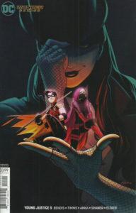Robin and Spoiler in Zatanna's hand