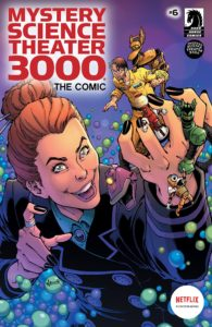 Cover for Mystery Science Theater 3000: The Comic #6 (Dark Horse Comics, 2019) - A red-haired womain holds the MST crew in miniature in her palm, grinning evilly