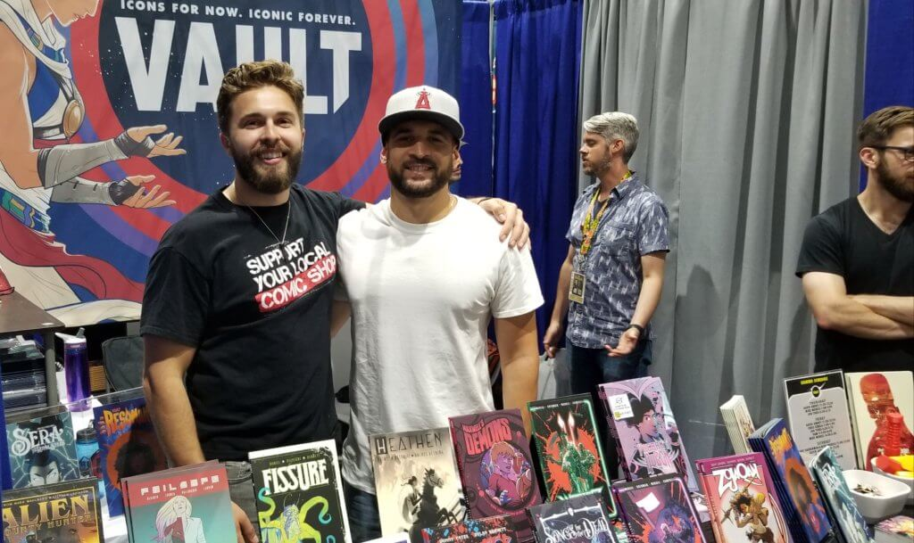 Nathan and Adrian show off Vault comics at their booth