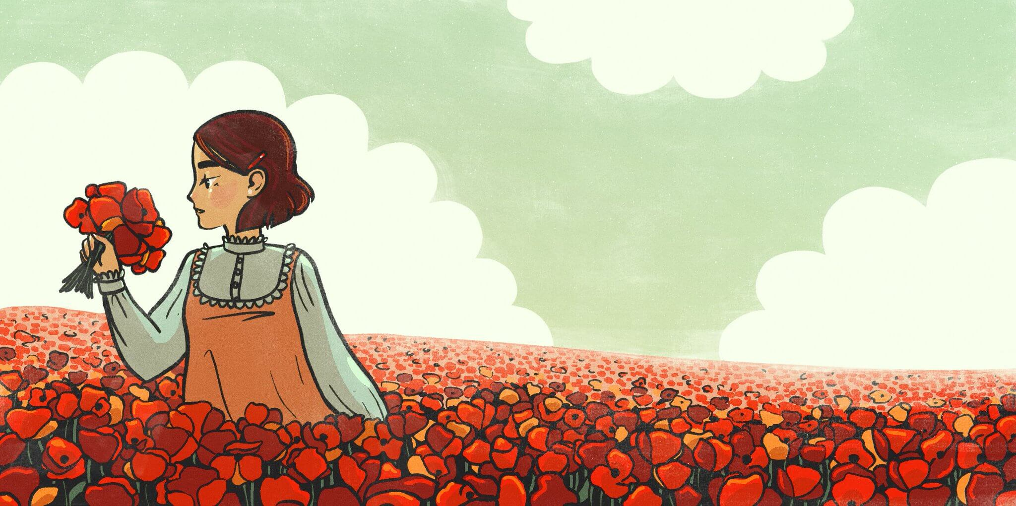 A girl stands in a field of flowers.