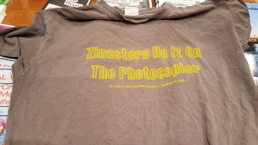 "QZAP T-Shirt that reads ""Zinesters Do it on the Photocopier."""