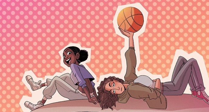 A girl smiles at the camera while another, lying on her back beside her, holds up a basket ball