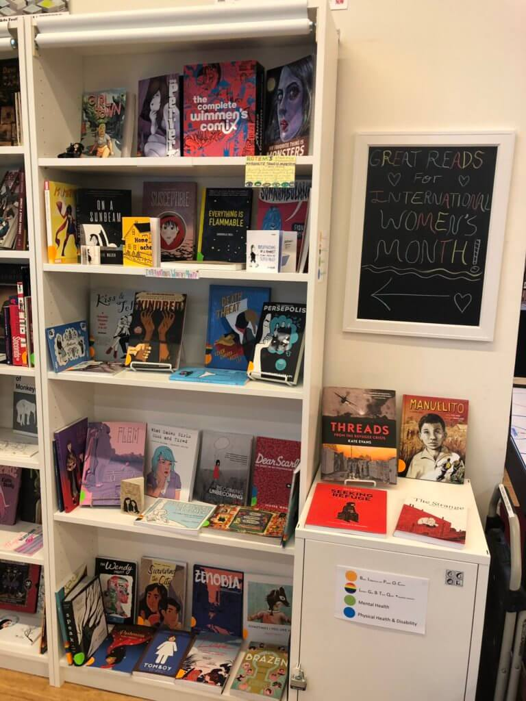 Shelves of comics for International Womens Month