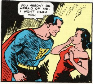 Superman looms over Lois Lane and assures her that he will not hurt her