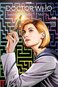 A blonde woman holding a sonic screwdriver on a maze background