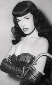 A black and white picture of actress and pinup star Bettie Page