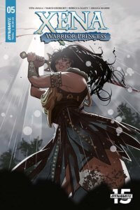 Rachel Stott cover. Xena stands over a defeated victim about to deliver a final blow in a forest with sunlight streaming down on her. Xena #5. Vita Ayala (writer), Paulina Ganucheau, David Mack, Rachel Stott (covers), Vasco Georgiev (art), Ariana Maher (lettering), Rebecca Nalty (colors), C Dynamite Comics August 14th, 2019