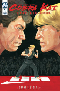 Cover for Cobra Kai #1. IDW Publishing October 2019 - Two heads face each other over an image of Johnny in black karate uniform