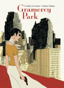 Gramercy Park cover. IDW Publishing October 2019 - A woman with short black hair stands overlooking a cityscape, holding a gun
