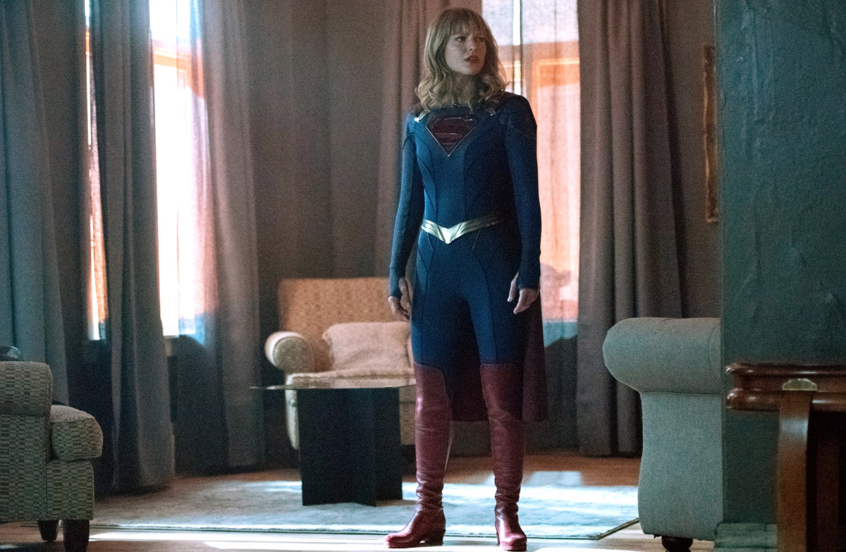 Blurred Lines - Supergirl standing in an apartment