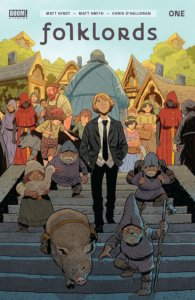 Folklords #1 cover by Matt Smith depicting suit-and-tie wearing series protagonist Ansel walking through his fantasy village