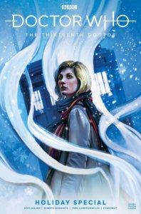 A blond woman (the Doctor) in a coat, with the TARDIS in the background and snow falling on the scene