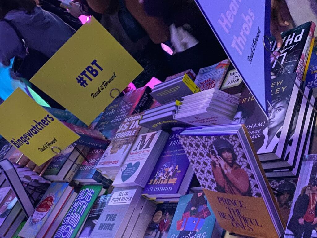 books are displayed with categorizing signs