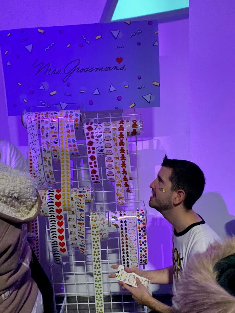 a person in profile next to a display of stickers
