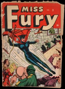 Miss Furry appears in a black leotard and swings in to the frame on a rope