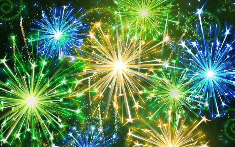 blue green and yellow fireworks exploding