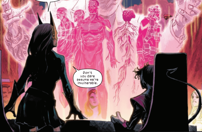 Jean Grey stands before a cocoon of bodies in pink chambers
