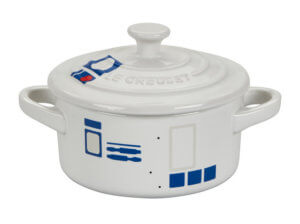 a small pot is decorated like r2d2