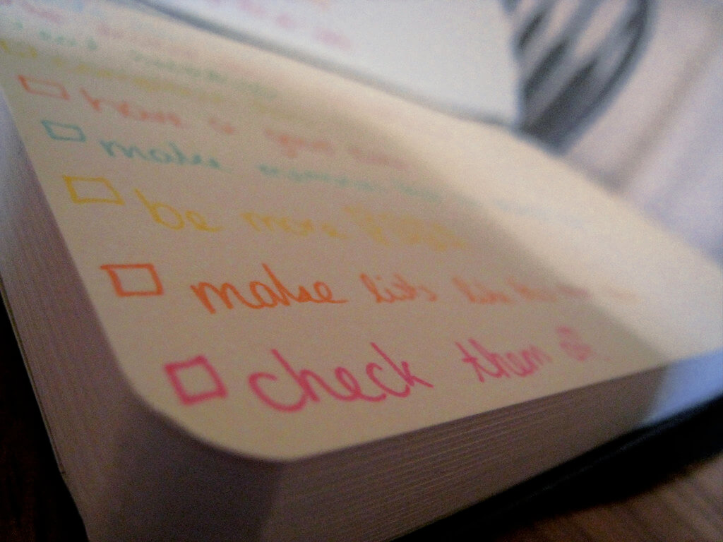 a notebook with checklists