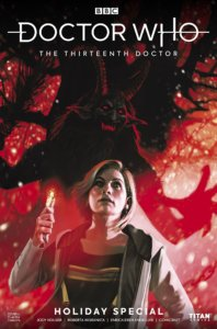 The Doctor, holding a sonic screwdriver, with the shadow of Krampus behind her.