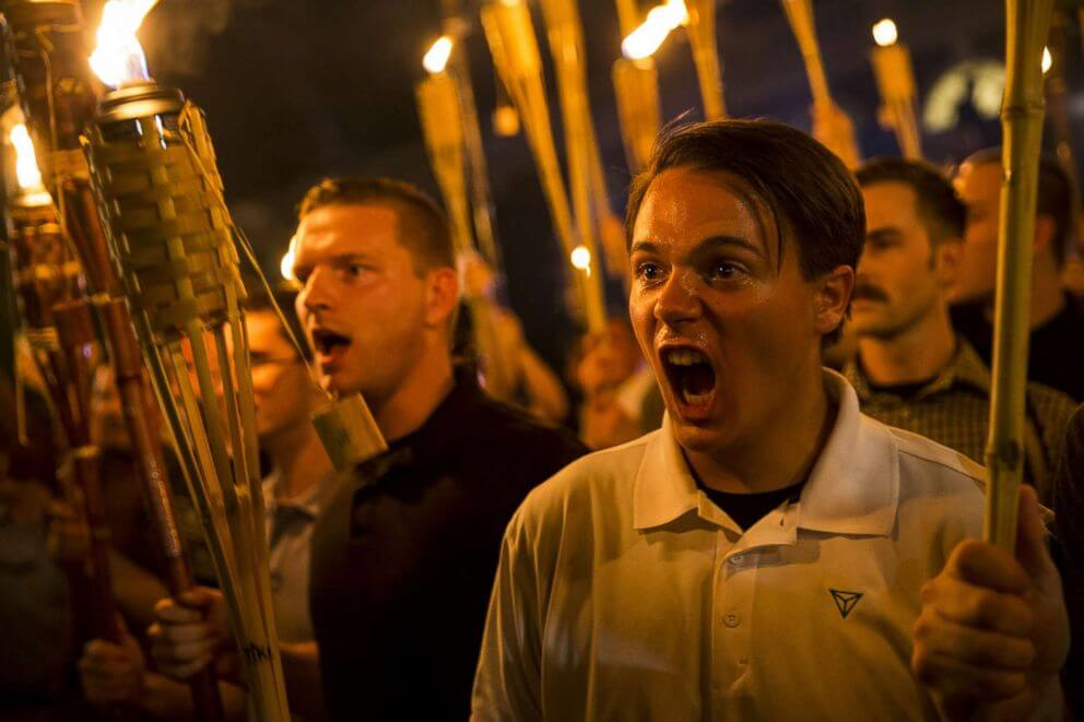 Fascists with torches are shown screaming.