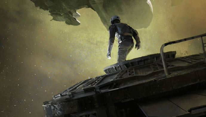 A person in a space suit walks across a ship hull