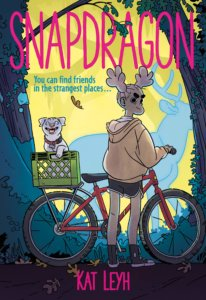 Cover of Snapdragon - Illustration of a light skinned girl with two curly pigtails standing next to a bike with a white dog in the basket, they're framed by two trees and a light blue outline of a stage in the background of the forest scene.