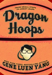 Cover of graphic novel Dragon Hoops features a close up of a basketball in the background with a cartoon face with short black hair glasses and no mouth under the title on top.
