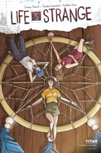 Three women lying on an extra large dream catcher, staring upward at the sky