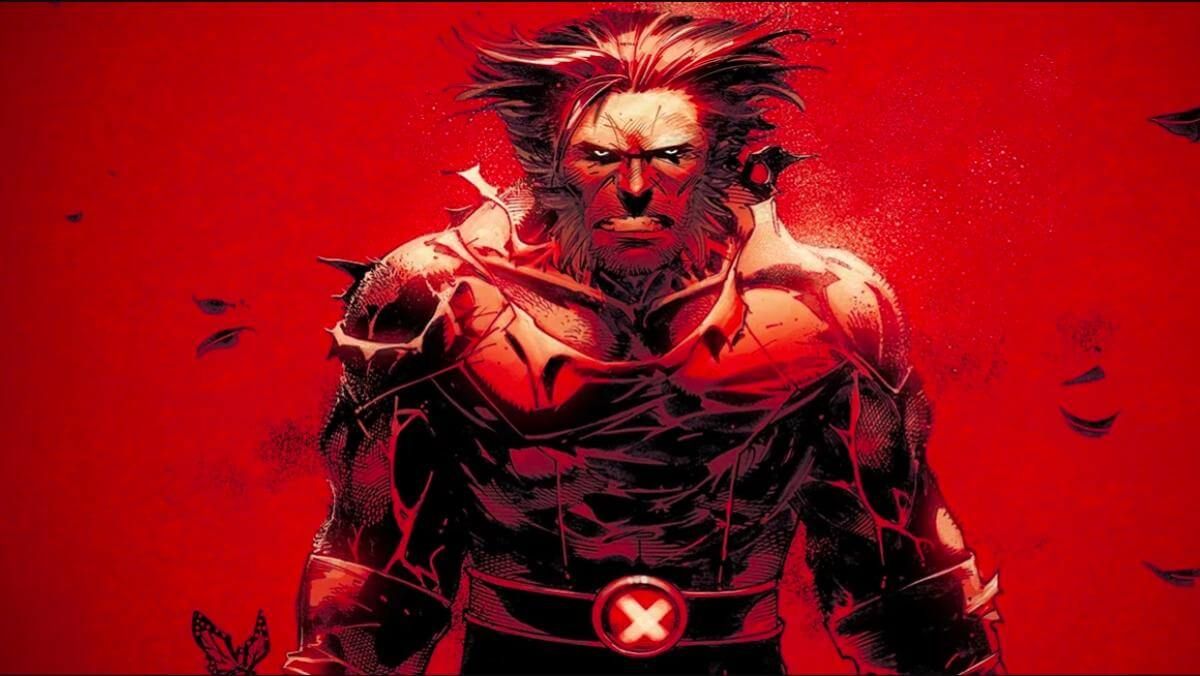 Wolverine stands looking angry on a red background