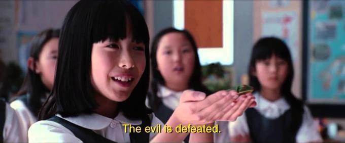 """A still from the 2012 movie Cabin the Woods, with a young Japanese girl saying """"The evil is defeated."""""""