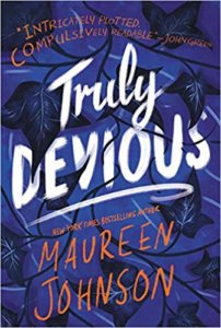 the cover of Truly Devious by Maureen Johnson has handwritten words over a dark background