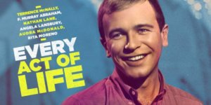 Poster from Documentary on Terrence McNally, Light Skinned with blond hair man smiles at camera
