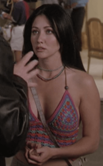 Prue wears a strange knit halter top. Image from Netflix.