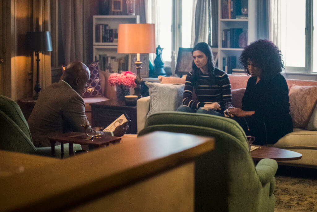 Nia (Nicole Maines) and Yvette (Roxy Woods) report Yvette's assault to Detective Rivers (Doron Bell)