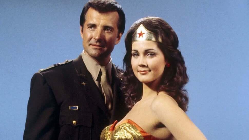 Wonder Woman stands next to Steve Trevor from the original WW series