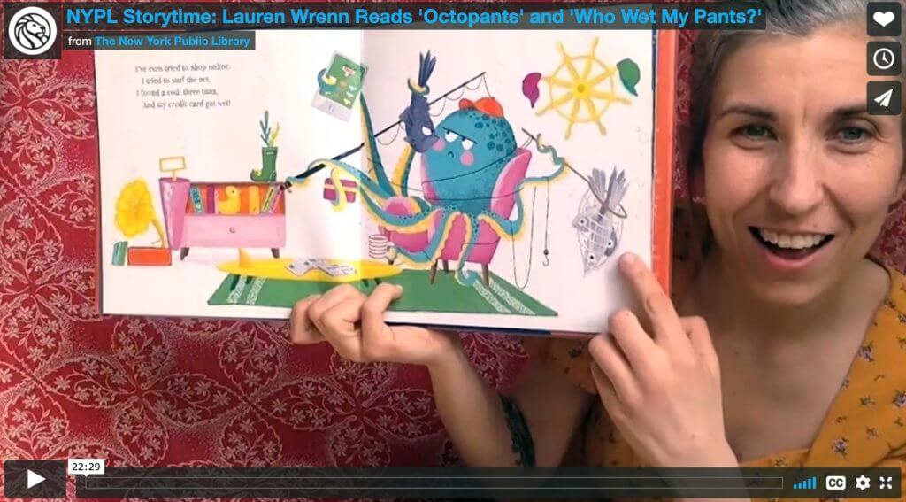 a librarian holds up an open picture book in a still from a video