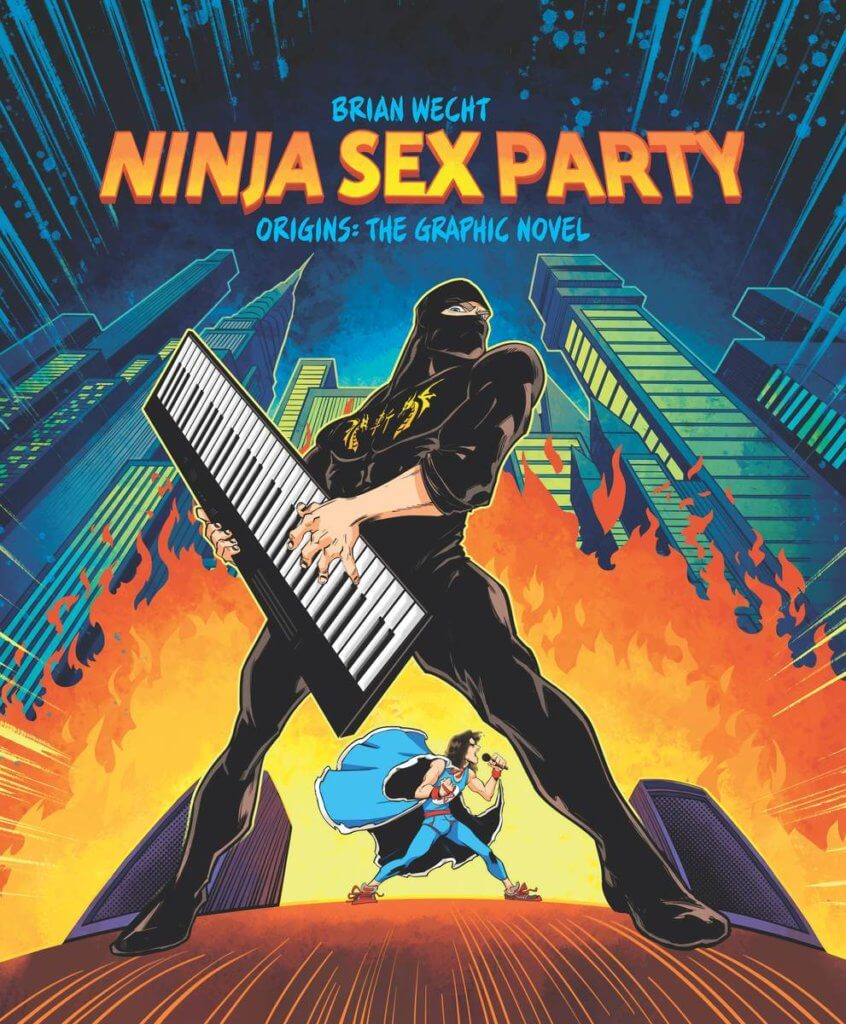 Ninja Brian - a Ninja in a black uniform with a golden symbol on his chest - stands before flames holding a keytar. In the background, Danny Sexbang - a ninja in a blue leotard with a cape - strides purposefully about in the background while singing. They are in city and it is pitch dark outside.