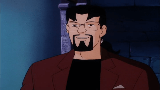 Ben Ravencroft, a white man with glasses, black hair, and a goatee, from Scooby-Doo! and the Witch's Ghost, Warner Bros. Animation & Hanna-Barbera Cartoons, 1999