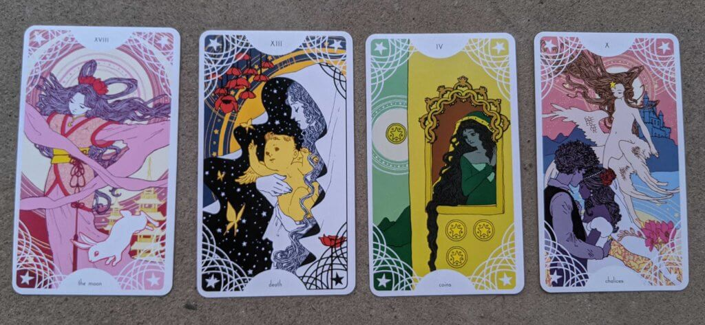 Four cards from Trungles' Star Spinner Tarot: the Moon, Death, the 4 of Coins, the 10 of Chalices
