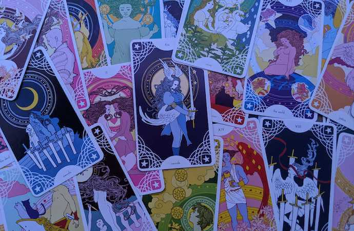 A scattering of various cards from Trungles' Star Spinner Tarot