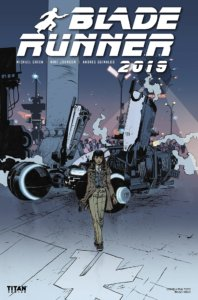 A dark haired woman in a suit holding a gun walks away from a crashed spaceship.