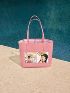 A pink bag plastered with comic strip panels of Veronica Lodge - a teenage dark-haired girl - sits beside a pool